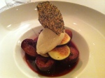 Poached figs with a red wine sauce, vanilla bourbon ice cream and a sesame cracker